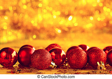 Christmas baubles - Red Christmas baubles over golden bokeh ...