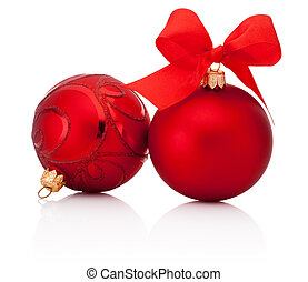 Red christmas baubles with ribbon bow isolated on white background