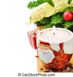 Red Christmas candle on festive background