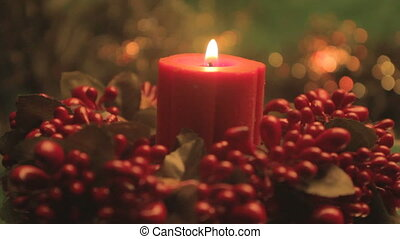 red Christmas candle with holly - revolving Christmas candle...