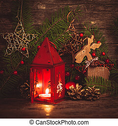 Red christmas candlestick over holiday decorations on the...
