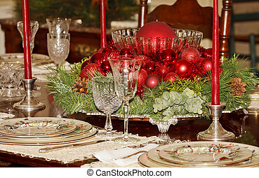 A formal dining table decorated for a Christmas dinner