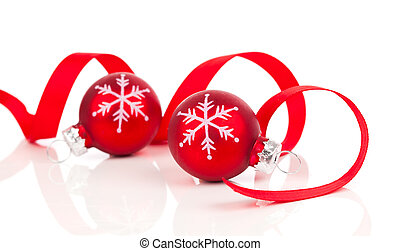 red christmas decoration balls with satin ribbon, isolated on white background
