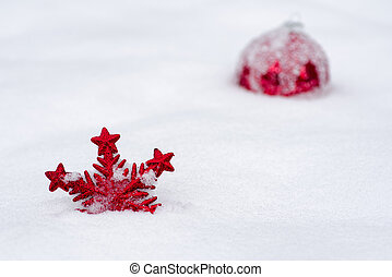 Red christmas decoration in the snow