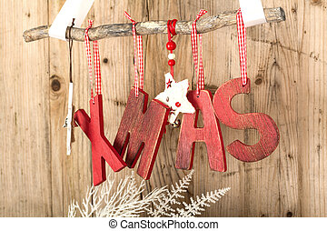 Red Christmas Decoration on brown wooden vintage background