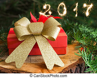 red Christmas gift on wood and tree background