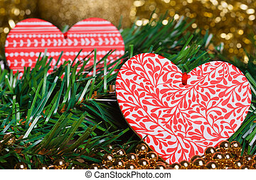 Red christmas hearts with green fir-tree branch