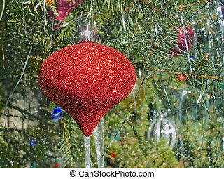 Red Christmas ornament on a tree