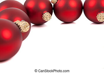 Red christmas ornament/baubles on white with copy space