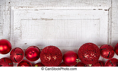 Red Christmas ornaments on wood panel