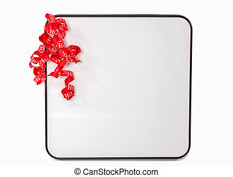 red Christmas ribbon on white board