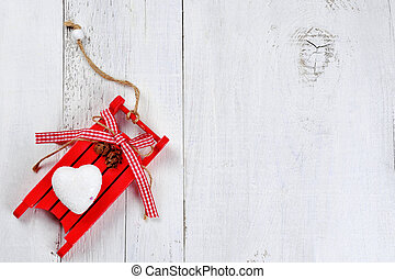 christmas sled on wooden background