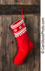 red christmas sock with snowflakes for Santa gifts