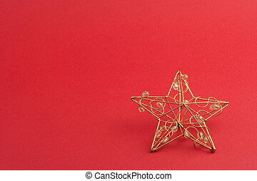 red christmas star against red background with copyspace