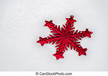 Red christmas star in the snow