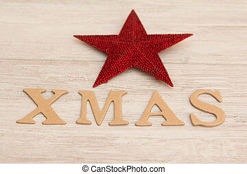 Red Christmas star with the word Xmas