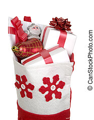 Red christmas stocking filled with presents on white background
