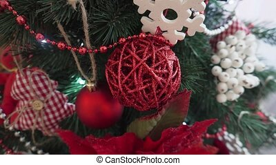 Red Christmas toy, brilliant wicker on the Christmas tree.