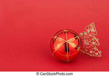 red christmas tree ball and christmas tree on red background...