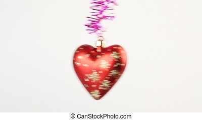 Red christmas tree heart swing on tinsel - Red christmas...
