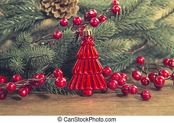 red Christmas tree on old wooden background