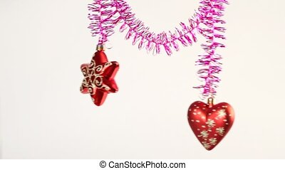 Red Christmas tree star and heart swing on tinsel