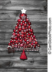 Red christmas tree with balls on old wooden shabby background.