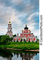 Red church on coast of the lake