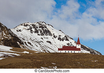 Red church on hill