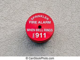Red circular fire alarm