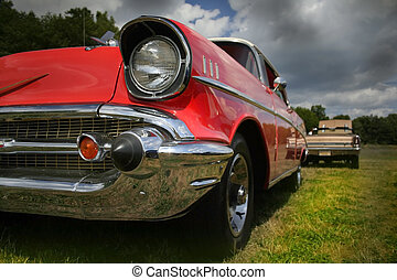 Red classic car wide angle shot showing head lamp