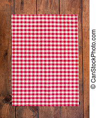 Red classic  Checkered tablecloth on wooden table, background with copy space