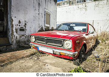 Red, classic,vintage car in a bit abounded place