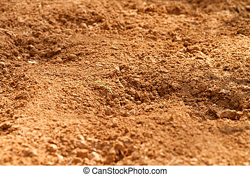 Red Clay Soil Dirt In A Farm Field - Close-up, shallow depth...