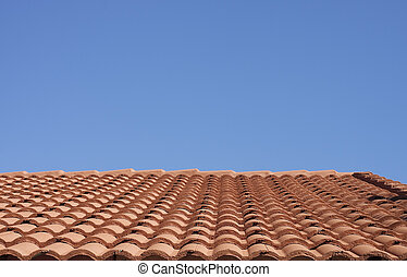 Red Clay Tile Roof Under a Clear Blue Sky