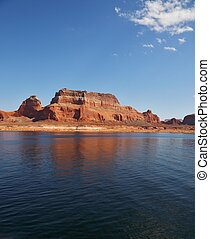 Red cliffs reflected in the smooth water