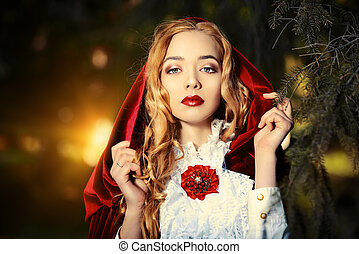 red cloak - Portrait of a stunning blonde lady in...