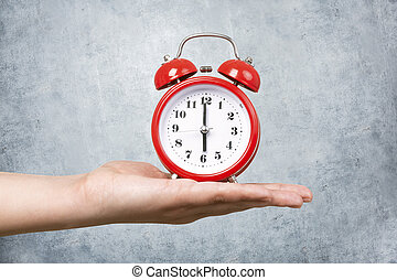 red clock with alarm