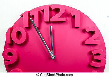 Red clock with five to midnight - Red clock showing five to ...