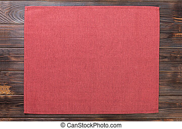 red cloth napkin on dark rustic wooden background top view with copy space