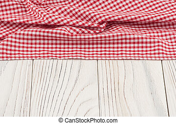 Red cloth on old white wooden table.