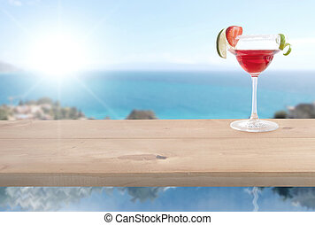 Red cocktail by the sea