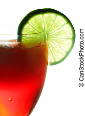 Red cocktail dressed with lime