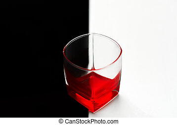Red cocktail in a glass on a black and white background