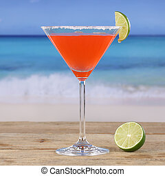 Red cocktail Martini drink on the beach