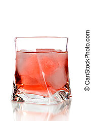 Red cocktail on a glass on white ba