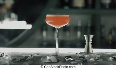 Red cocktail on the bar.