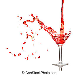 Red cocktail splashing from glass