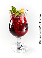 Red cocktail with fruits in a glass