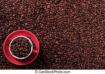 Red coffee cup filled with beans top view